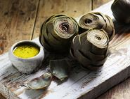 Artichokes with Parmesan & Herb Butter Sauce