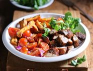Jerked Chicken with Sweet Potato Fries & Tomato Salad